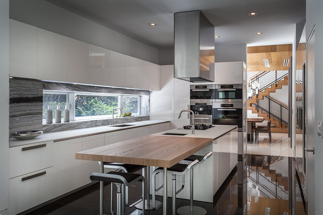 A view of the kitchen.  Photo 8 of 12 in This Modern Miami House Feels Like It's in the Middle of the Jungle
