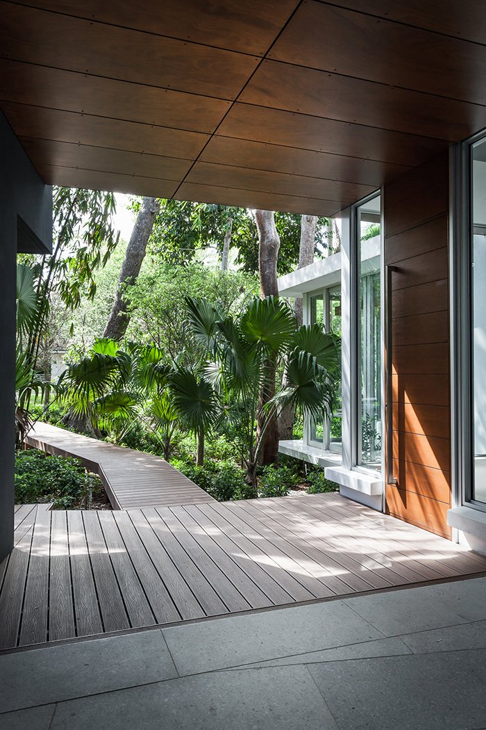 """""""It didn't seem like the kind of landscape you wanted to go trudging through with your boots, but one that you wanted to observe with detachment,"""" architect Allan Shulman says.  Indoors/Outdoors from This Modern Miami House Feels Like It's in the Middle of the Jungle"""