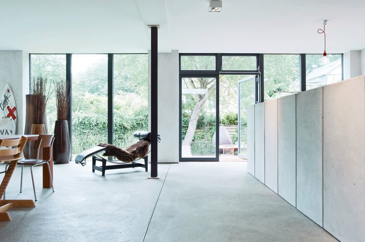 The owners of this home decided to limit their color palate to wood tones, black, and gray. The LC4 fits right in.  Photo 9 of 10 in The Woman Behind Le Corbusier's Iconic Chaise Almost Didn't Get the Job