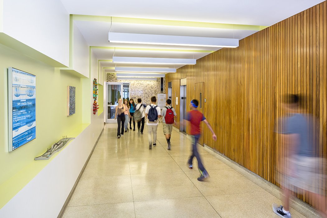 """""""The circulation areas are more than just ways to get places, but spaces you actually want to be and hang out in,"""" says Eric Hass, a principal at DSH.  Photo 4 of 11 in 11 Innovative and Modern Schools Where Creativity and Good Design Rule from A Forgotten Insurance Building Finds New Life as a Humming High School"""