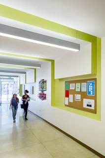 Lime wall insets enliven the school's hallways.