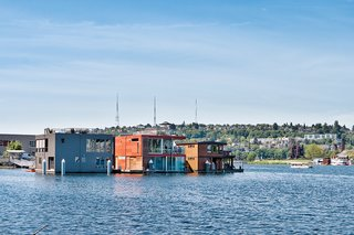 This colorful floating home eschews maritime themes in favor of a clean and contemporary aesthetic. The interior pulls in views of Lake Union through floor-to-ceiling windows.