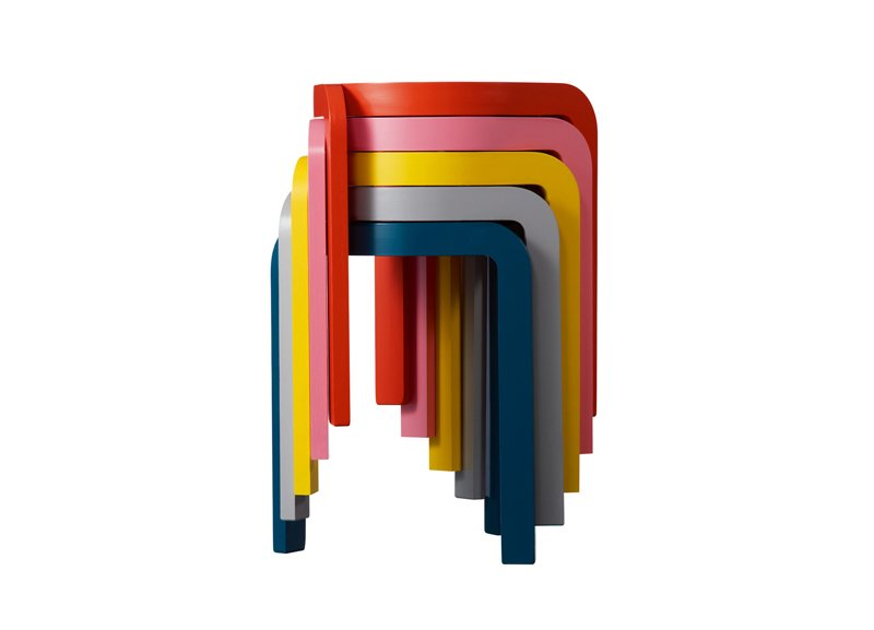 Being able to stow away extra seating is a necessity for small space entertaining. These lightweight Spin Stackable Stools stack up in a rainbow spiral for easy storage.  Perfect Pieces for Small Space Living by Megan Hamaker