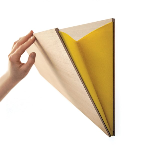 Unobtrusive and easily mounted, the Leaning Wall Pocket, a simple but sturdy storage pouch, is made in Belgium from plywood and comes in 12 different colors of felt.