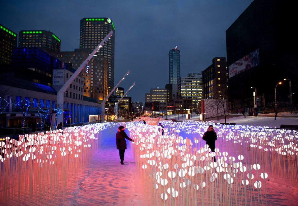 Entre les Rangs was KANVA'swinning entry in the fourth annual Luminothérapie competition, which challenged designers and artists to create an immersive winter experience. The installation consisted of thousands of flexible stems topped with white reflectors.  Photo 1 of 8 in Montreal Firm Receives Emerging Architectural Practice Award