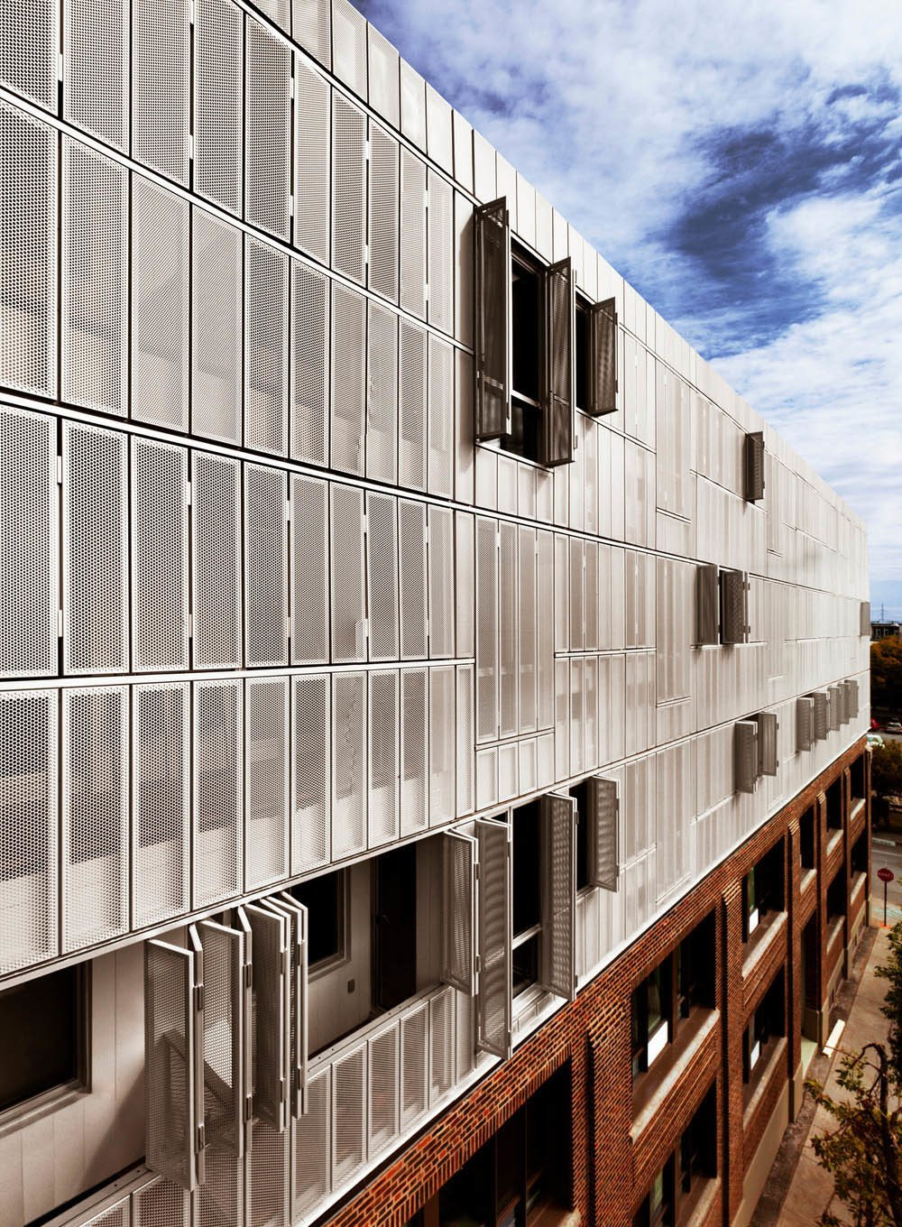 Irène, an apartment building in Montreal's St-Henri borough, features a metallic skin with panels that open and close.  Photo 5 of 8 in Montreal Firm Receives Emerging Architectural Practice Award