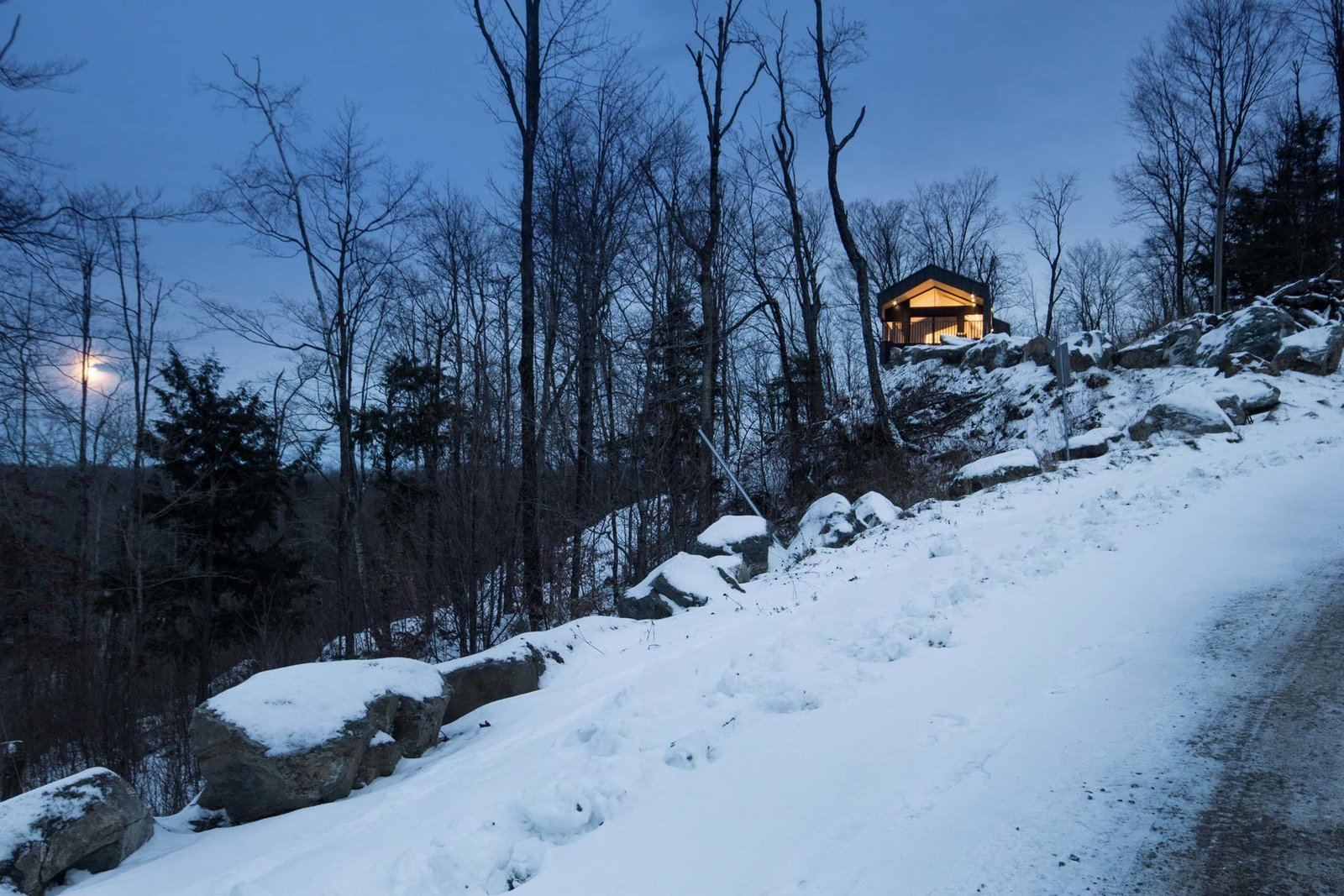 The home's elevated location means its occupants can enjoy the slow rise of the full moon while staying warm indoors.  Photo 11 of 11 in Amazing Cantilevered Home in the Mountains