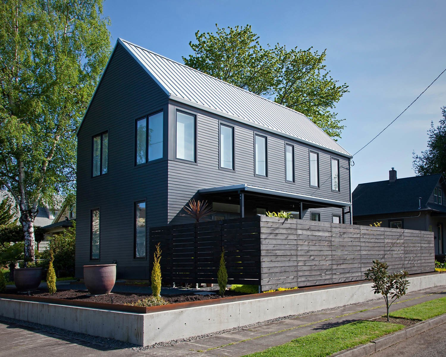 Outdoor, Side Yard, Wood Fences, Wall, and Horizontal Fences, Wall Scott Pitek designed this gabled structure for Betty Rahman on a 5,000-square-foot lot in Portland, Oregon.  Siding from Modern Gabled House in Portland