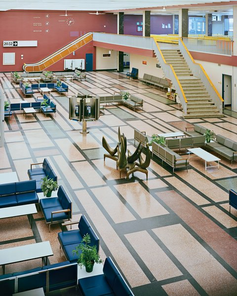 """The international transit lounge at Gander Airport has retained its mid-century Robin Bush seating and Mondrianesque terrazzo floor. Senior curator Rachel Gotlieb from the Gardiner Museum in Toronto says that selecting such modern trimmings for the point-of-entry """"was the beginning of a long march to show that Canada was a progressive nation."""""""
