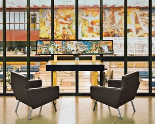 Gander's lounge sports a 69-foot-long, 12-foot-tall mural by Canadian artist Kenneth Lochhead, overlooked by Christen Sorensen armchairs.