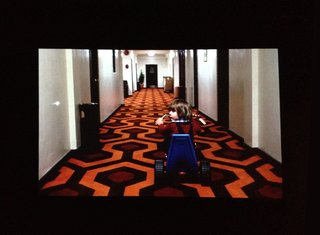Upon walking into the exhibition, two films are projected side by side (seen here, Kubrick's 1980 horror classic, The Shining) in a big, dark room. Visitors can either sit and marvel or merely pass on by.