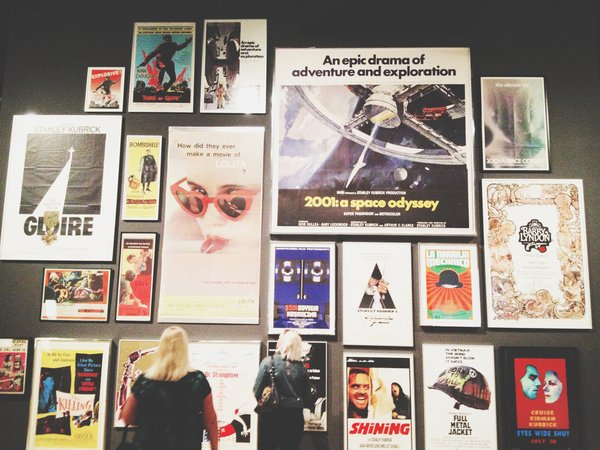The director's career in film, in the form of posters, line the wall.