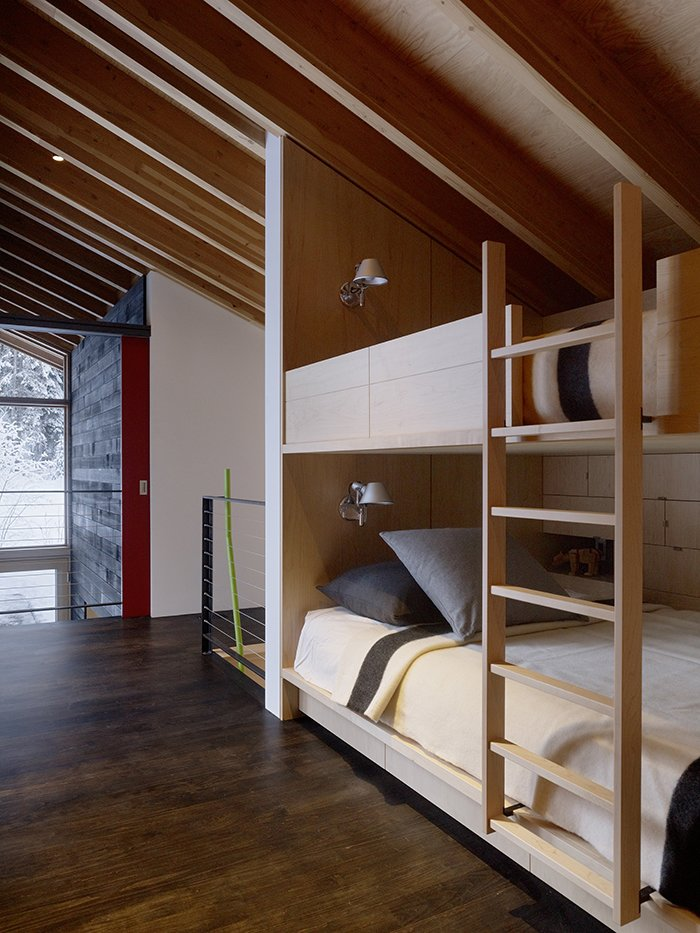 The residents, who live in Calgary, frequently entertain, and with 16 beds, bunks, and twin-bed-wide window seats, there is no shortage of places to sleep.  Photo 3 of 3 in Modern Weekend Ski Home