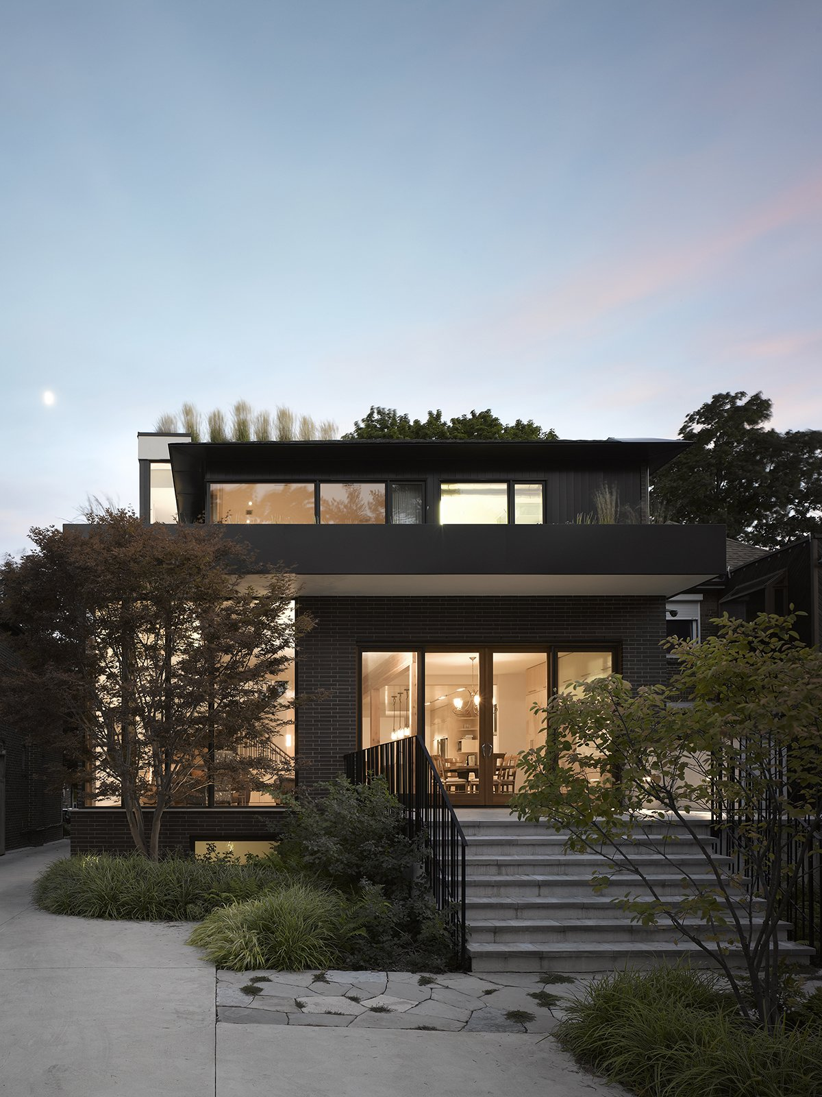 Exterior, House Building Type, and Brick Siding Material The majority of windows are on the south facade to optimize solar gain.  Photo 11 of 11 in Smart Tech Makes this Modern Home Ultra Energy Efficient