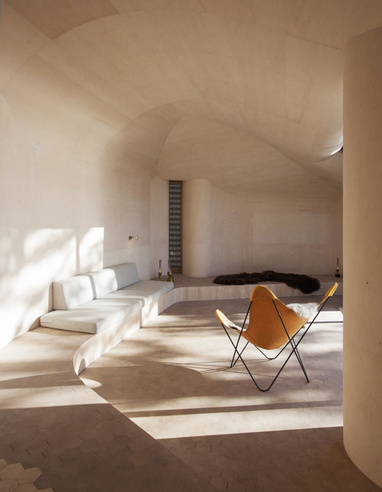 "The cabin's undulating curves are fixed by a prefabricated, laminated wood structure with a subdivision of Kerto CNC-milled plywood. ""It defines the geometry of both the interior and the exterior,"" Bae Brandtzæg says.  Minimalist from Stand-Alone Statement Chairs"