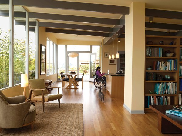 """Having lived in, and loved, a modern house built in 1954 in Seattle's Magnolia neighborhood since buying it in 1996, architect Karen Braitmayer and her husband, marine mechanic David Erskine, recently came to realize that the house was overdue for some modifications. Braitmayer, whose firm, Studio Pacifica, specializes in universal access space planning and ADA compliance for commercial and residential projects, is a wheelchair user, as is her and Erskine's teenage daughter. With its open layout and single-floor plan, the house worked fairly well for many years, but, as Braitmayer says, """"It was really my daughter growing up that spurred us to make some changes. Her disability is a little bit different from mine, and some of the things I was able to work around for a long time weren't going to work for her."""" Braitmayer called in another architect, Carol Sundstrom of Seattle-based Röm Architecture Studio, who specializes in single-family remodels and with whom Braitmayer has collaborated on many projects."""