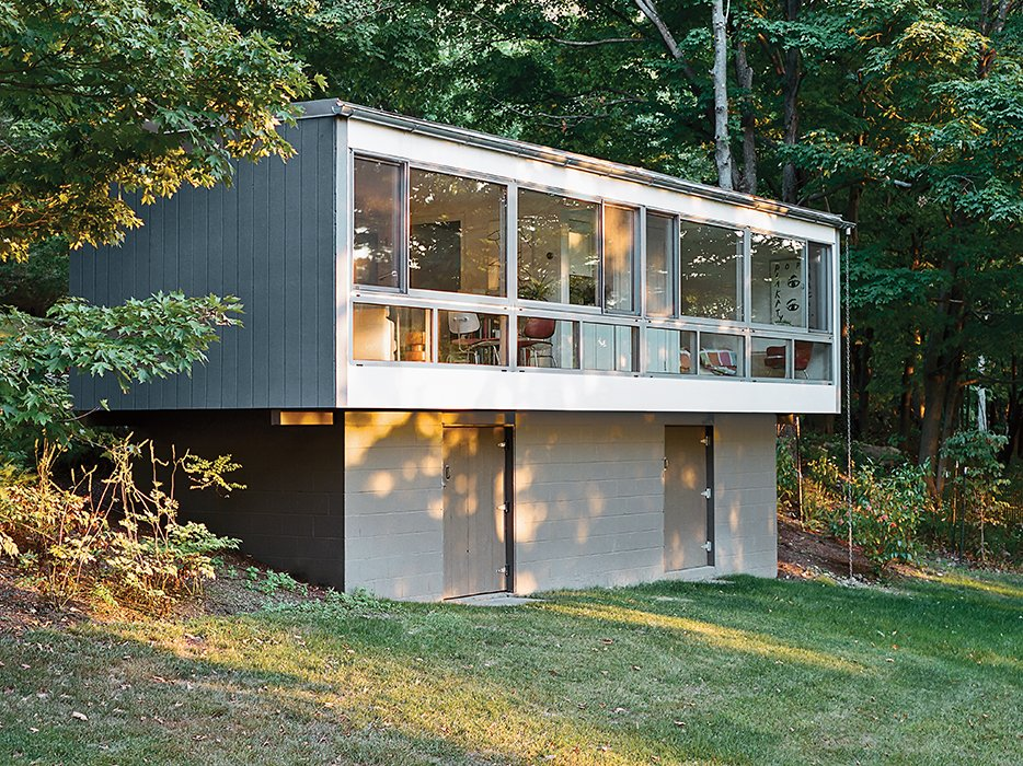 He replaced the remaining facade with a custom curtain wall by Arcadia that affords a sweeping view of the property.  Photo 8 of 13 in Can You Believe This House Used to be a Dilapidated Toolshed?