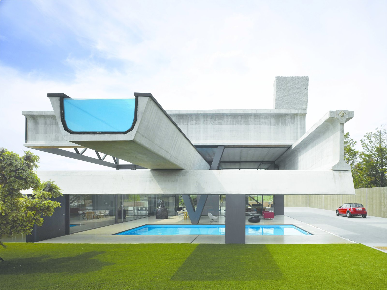 Outdoor, Swimming Pools, Tubs, Shower, Lap Pools, Tubs, Shower, Concrete Patio, Porch, Deck, Back Yard, and Grass Precast concrete beams typically used for highways are repurposed in the creative Hemeroscopium House by Ensamble Studio in Madrid.  Photo 11 of 11 in 10 Works of Architecture That Reveal the Acrobatic Wonders of Concrete from Truly Imaginative Buildings Around the World