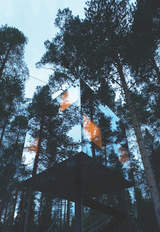 This tree house in Sweden with a mirrored exterior by Tham and Videgård Arkitekter is just large enough to host two people.