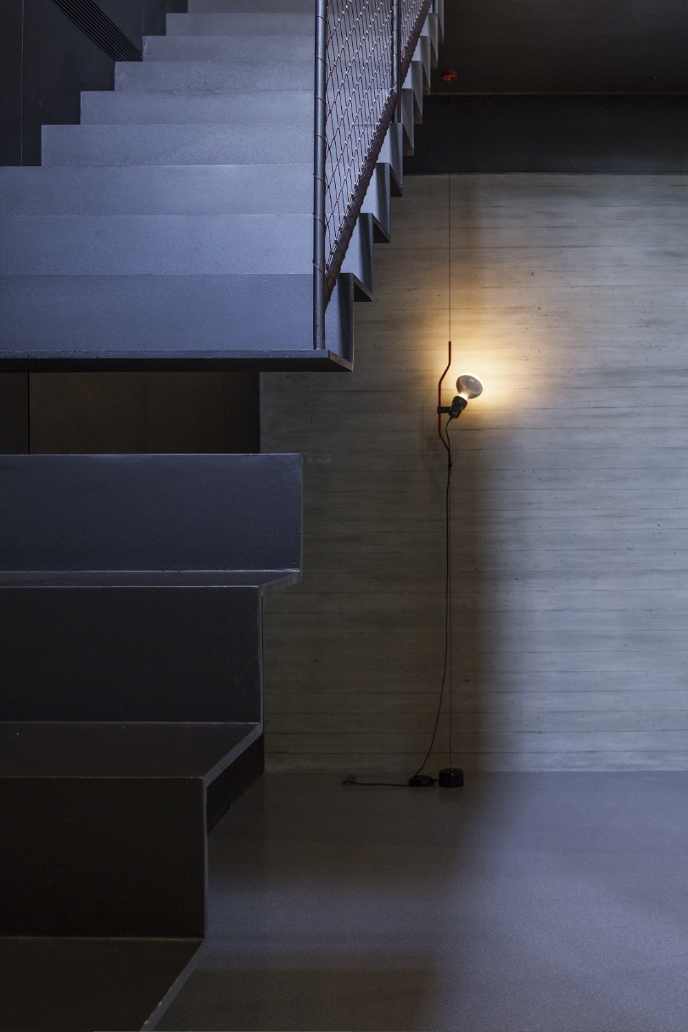 Pitsou Kedem's unique twist in the new basement is a two-part metal staircase with a gap in the middle. A slim Parentesi Floor Lamp illuminates the space.  190+ Best Modern Staircase Ideas from Minimal Reboot