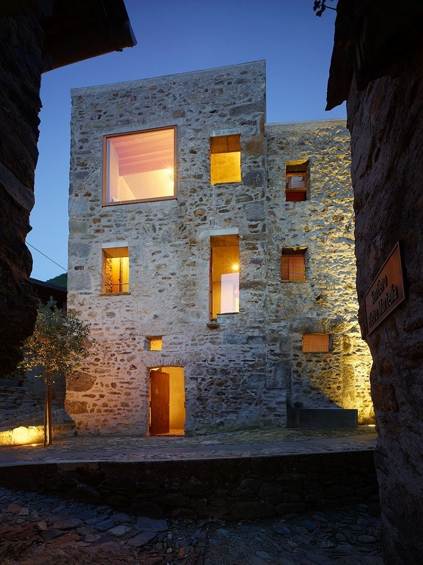 The renovation of this old stone structure by Wespi de Meuron Romeo architects was, at times, as much archeology as architecture. The small square in front of the building, the only in the village of Scaiano, dates the building, a former brandy distillery fortified with both spiritis and stone walls. After reinforcing the roof and replacing the wood beam floors with concrete, the team started to dig in.  Scaiano Stone House by Patrick Sisson