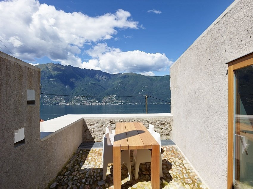 Despite the raw materials and rocky walls, the upstairs terrace feels positively weightless, offering spectacular views of Lago Maggiore.  Scaiano Stone House by Patrick Sisson