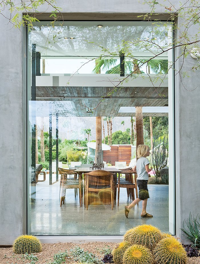 """When this midcentury home near Palm Springs got its modern makeover, the homeowners asked local architect Sean Lockyer to showcase the desert's dramatic landscape. """"Our idea,"""" says Lockyer, """"was to maximize the view and capture as much of the outdoor space, from property line to property line, as possible.""""  We Love These Walls of Glass by Brandi Andres"""