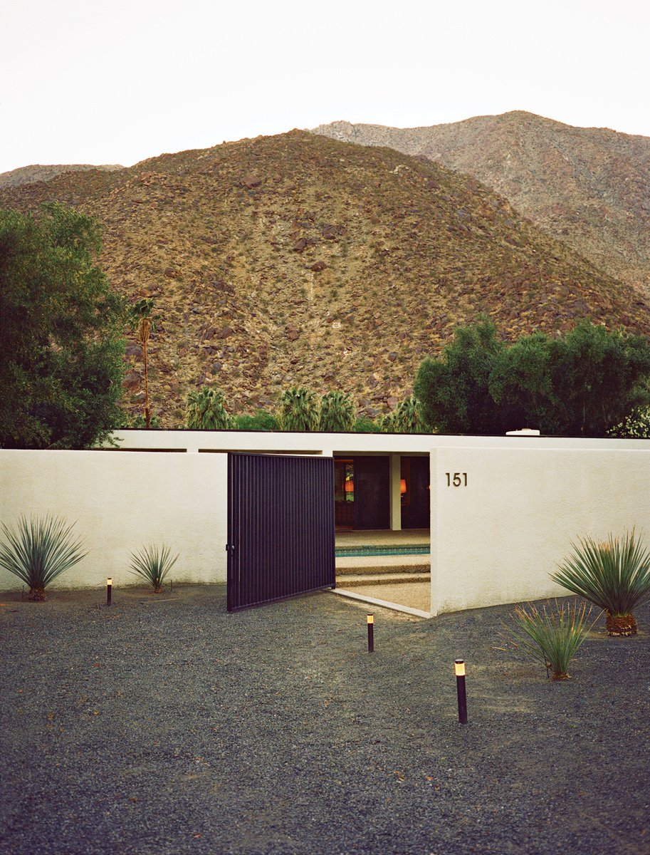 Doors and Exterior Architect Maurice McKenzie was inspired by symmetrical design, and the resulting linear and stark-white architecture makes a statement against the dry desert terrain. Photo by: JUCO  Exterior Renovation from Photographer Q&A: JUCO