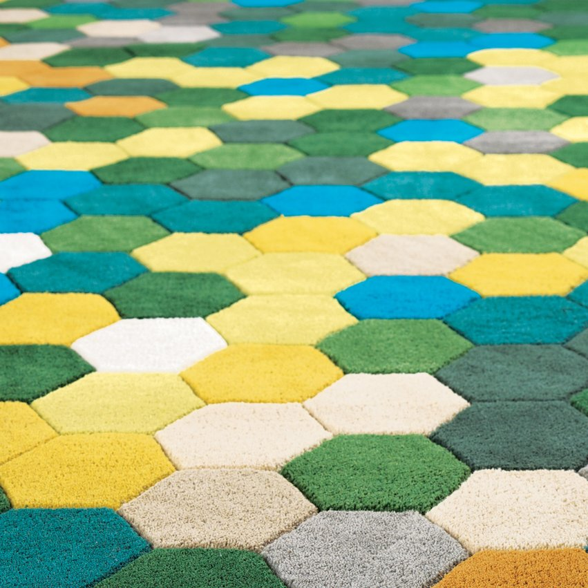 This hand-tufted Kaleidoscope Rug by BoConcept was inspired by pixelated kaleidoscope images. Definitely fit for the modern age.  Rug Collection