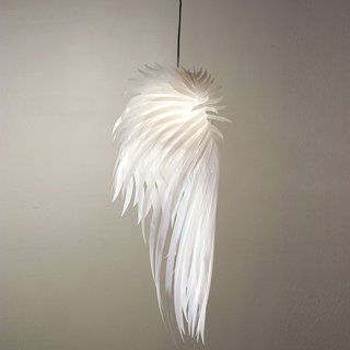Made from white mylar and multiple layers of polyester cut to resemble a hovering bird's wing, the Icarus Lamp is a striking homage to human aspiration and our source of life: the sun. Read  more about the Icarus Light here.