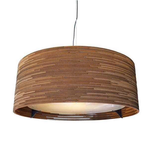 The Drum Scrap Light boasts a sturdy clear-coated steel frame, frosted-tempered-glass lens, handmade repurposed cardboard shade, and three light sockets inside. See more of this light here.