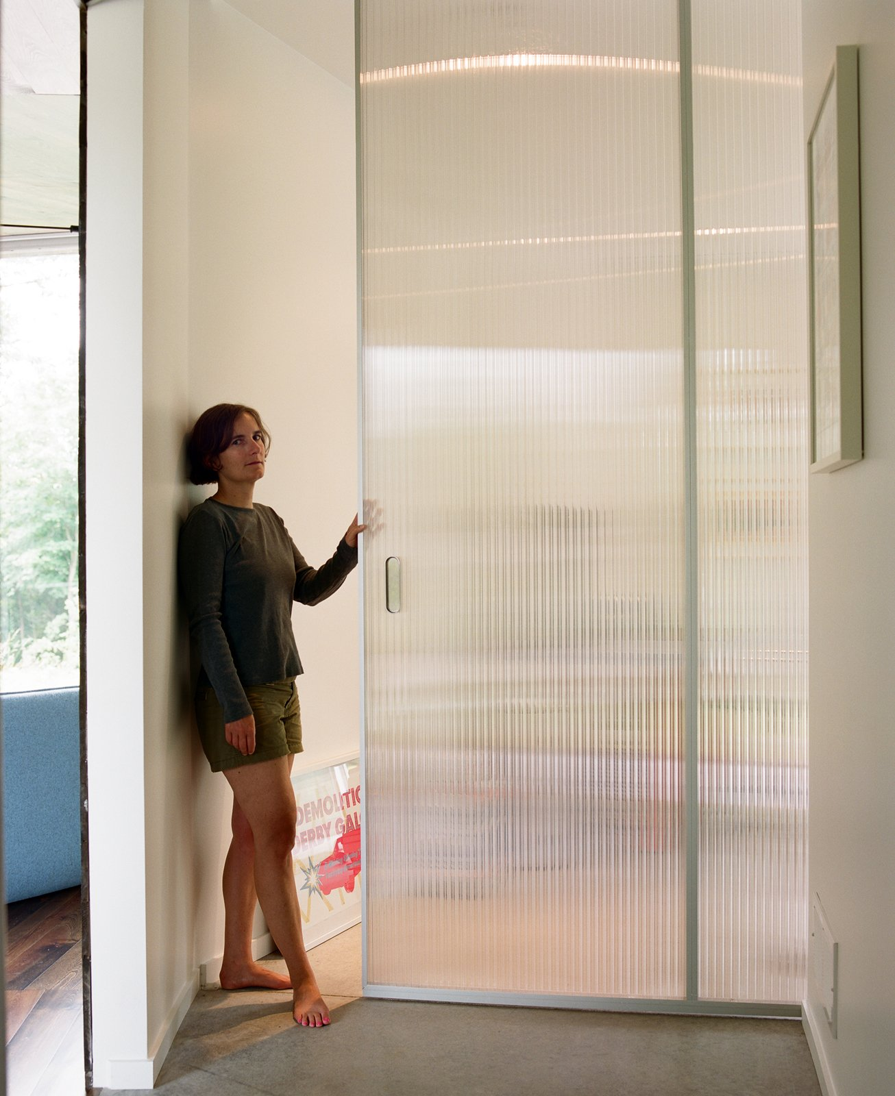 Doors and Sliding Door Type Pascal poses on the threshold of the living room, which can be closed off with a translucent pocket door, yet still take advantage of the light that pours in from all sides.  New Grass Roots by Dwell
