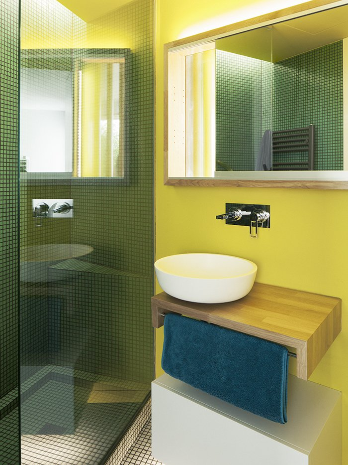 "Bath Room and Vessel Sink ""The bathrooms were conceived as special spaces,"" Vázquez says. ""We decided to give them some color that would contrast with the main spaces."" A vessel sink by Cubik rests on a custom oak base; the mosaic tile is from Mosaico.  Bathroom Ideas"