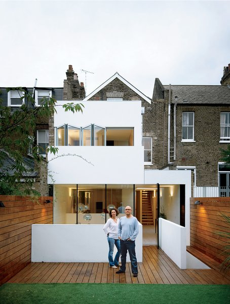 Small Patio, Porch, Deck, Wood Patio, Porch, Deck, Exterior, and Stucco Siding Material Corporate high-flyers and admitted neat freaks Bruce Thatcher and Kirsty Leighton couldn't handle the chaos anymore. Read more about this Victorian terrace in London here.  Best Photos from Black Sheep