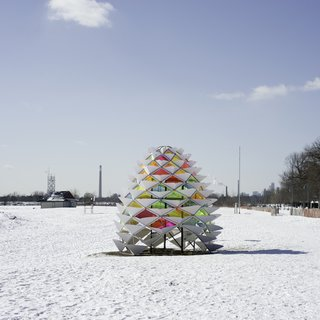 Snowcone: Lily Jeon and Diana Koncan (Ryerson University, Toronto)  A welcome burst of color against the white landscape, this geodesic, kaleidoscopic take on the warming hut was inspired by the natural shape of a pinecone and the insulating properties of an igloo.