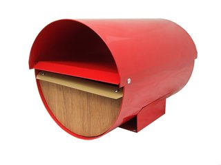 Cadrona in Red from Mailboxes.co, $150-A powder-coated zincalume body and marine plywood front means zero rust and mold from this New Zealand-made mailbox; a locked lower half keeps mail and packaged protected while the open upper half holds newspapers.