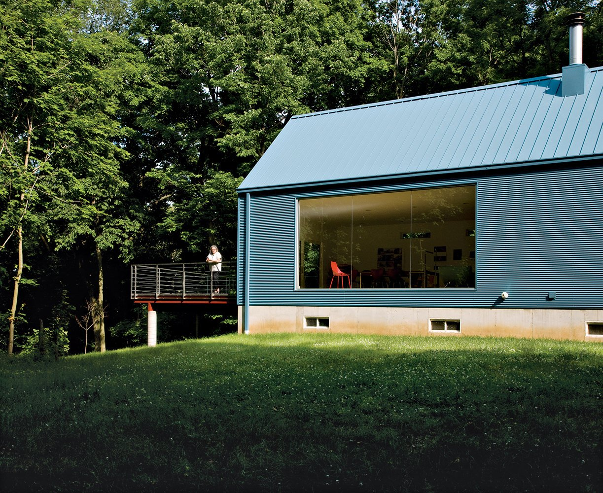 Lauren Ewing's stylish, but unassuming shotgun-style house in Vincennes, Indiana, is set into a hill overlooking a field she has known since childhood. Read more about this home made of local materials here.  20 Best Modern Homes from the Midwest by Erika Heet from One With Nature