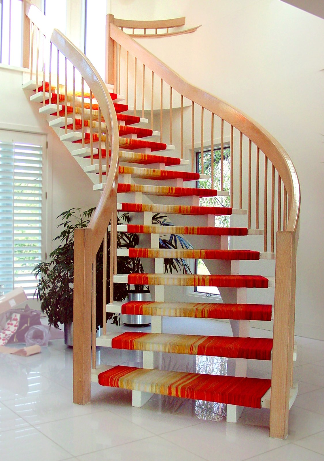 A fabric covered wooden staircase.  Photo 2 of 4 in A Chat with Designer Liora Manné