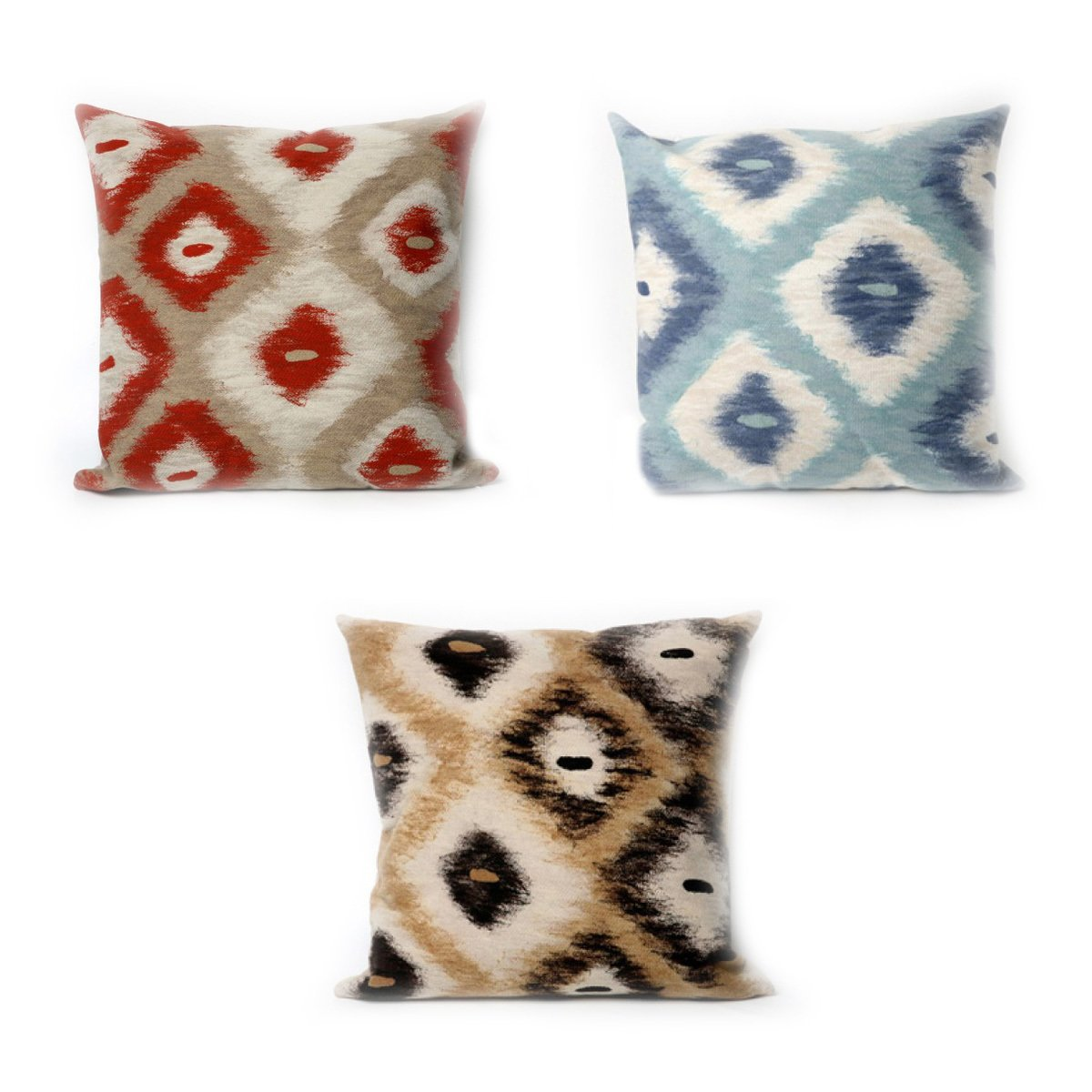 A trio of Manné's Ikat Diamonds pillows. From clockwise: Aqua, Black, and Red.  Photo 3 of 4 in A Chat with Designer Liora Manné