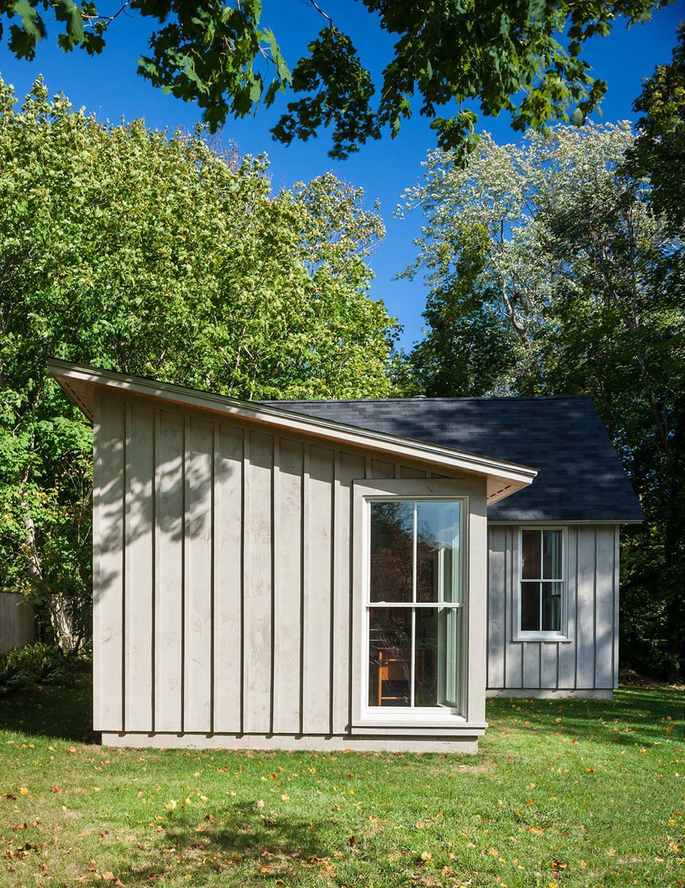 The siding is locally milled native white pine, with plywood soffits and Andersen windows.  Photo 3 of 7 in A Modern Live-Work Studio in Rhode Island