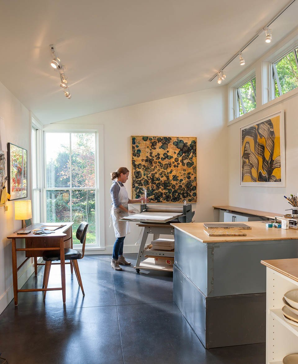 Jane Wright, a painter and printmaker, uses one end of the building as a studio. The space served as a lanuching pad for her new interior design business, Roost Modern.  One-Room Wonders from A Modern Live-Work Studio in Rhode Island