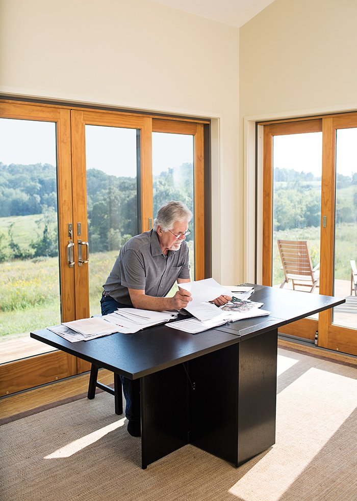 Office and Desk Wright, who teaches a course in visual literacy at Taliesin, works at a #101 dining table by Skovby.  Photo 3 of 8 in Grandson of Frank Lloyd Wright Constructs Peaceful Prefab Near the Legend's Famed School