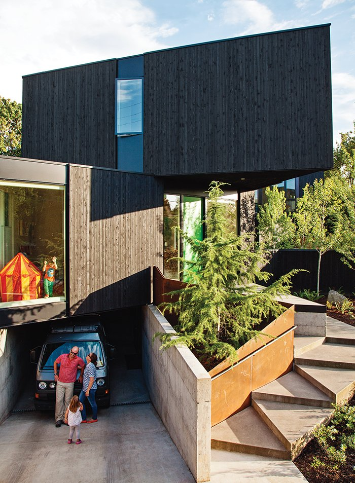 Outdoor, Trees, Front Yard, and Walkways The triangle is the home's leitmotiv, appearing in the cantilevered bedroom module and the steps approaching the entrance.  Modern Spaces in the Pacific Northwest by William Lamb from 28 Triangles Make Up This Hyper-Angular Family Home