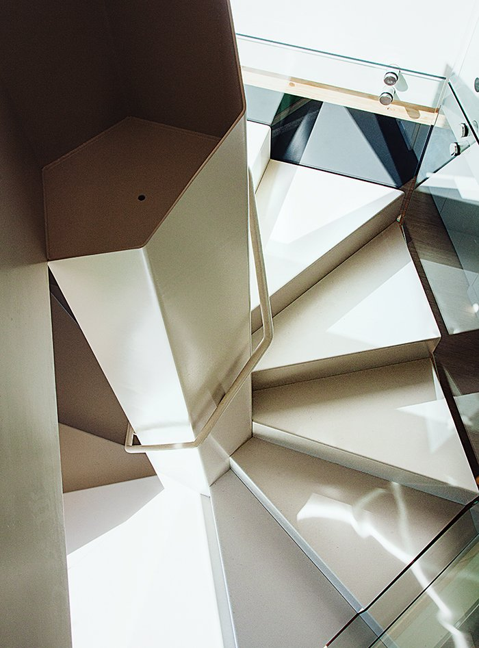 """""""There was nothing here. Eight hours later, there was a house made out of triangles,"""" says resident Kaja Taft. Tagged: Staircase and Metal Railing.  Photo 6 of 12 in 28 Triangles Make Up This Hyper-Angular Family Home"""