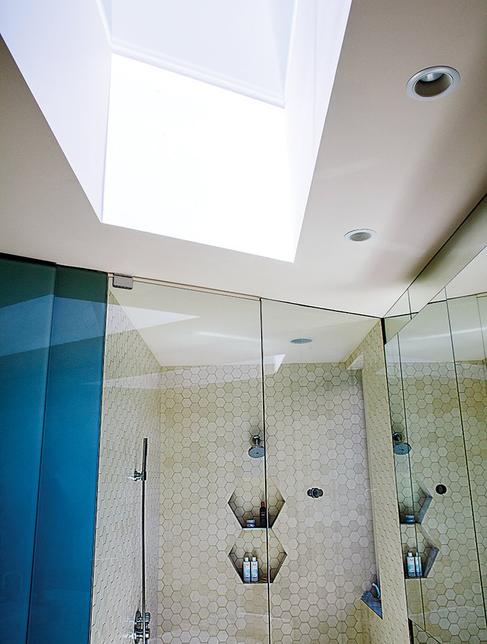 Bath Room and Open Shower The Hansgrohe sinks are paired with Duravit faucets.  Photo 9 of 12 in 28 Triangles Make Up This Hyper-Angular Family Home