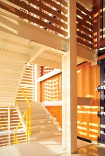 Mario Plasencia, the architect, used wood to wrap the exterior stairwell.