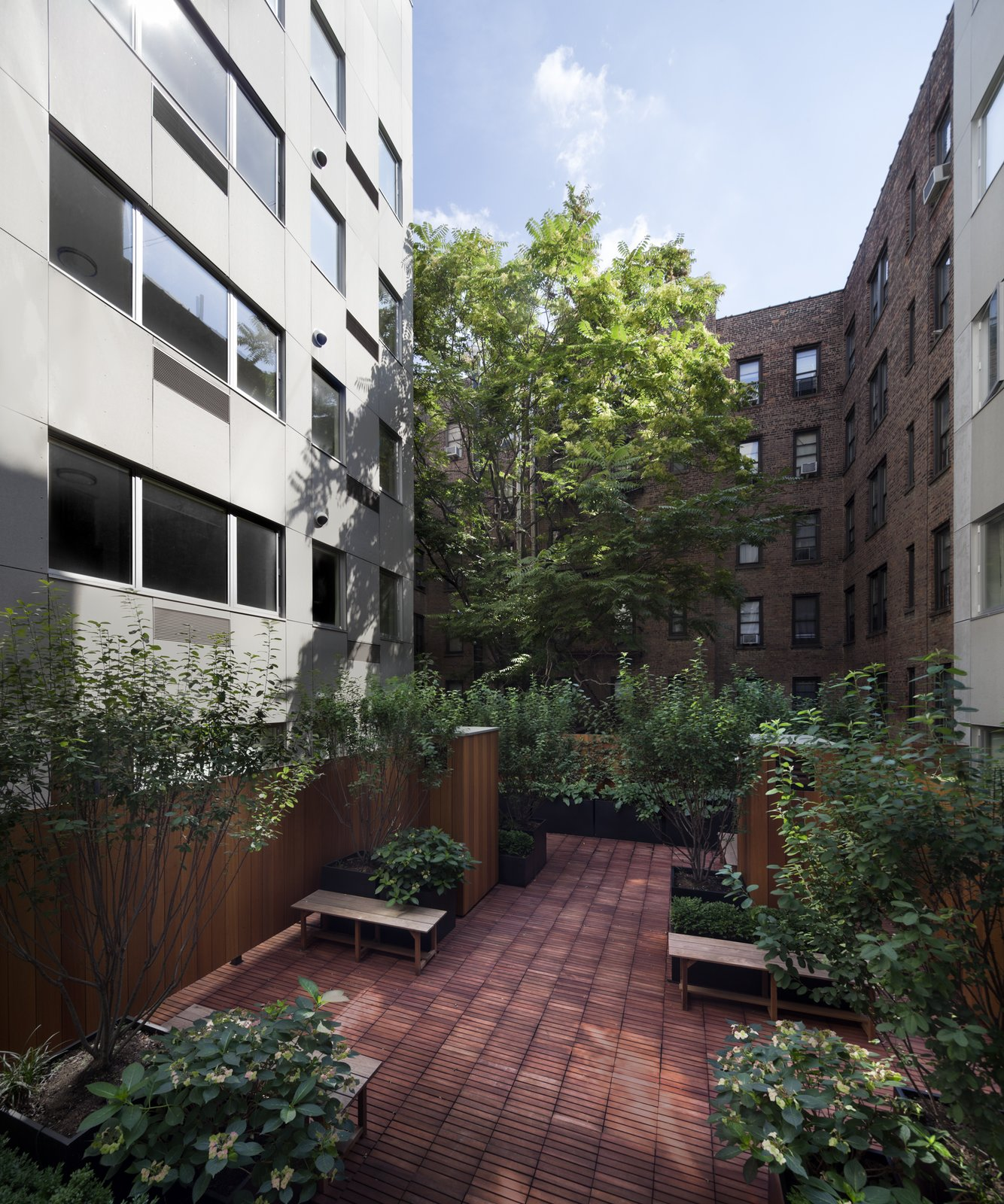 """Pockets of outdoor space are scattered throughout.  Search """"madrid couple remake apartment one their childhood buildings"""" from It Took Less Than a Month to Assemble this Entirely Modular Apartment Building in NYC"""