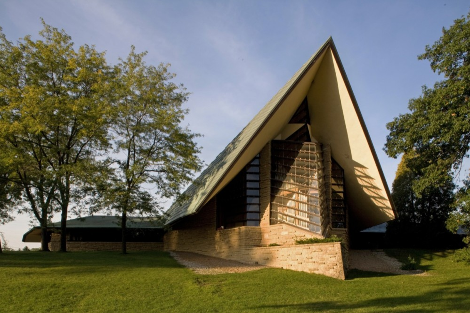 Exterior, A-Frame, Mid-Century, and Prefab The seeds for Frank Lloyd Wright's collaboration with prefab builder Marshall Erdman were planted when Erdman hired the architect to design the First Unitarian Society meeting house in Madison, Wisconsin. [Photo credit courtesy The Kubala Washatko Architects (TKWA) via ArchDaily]  Exterior A-Frame Mid-Century Photos from A Look at Frank Lloyd Wright's Little-Known Prefabs