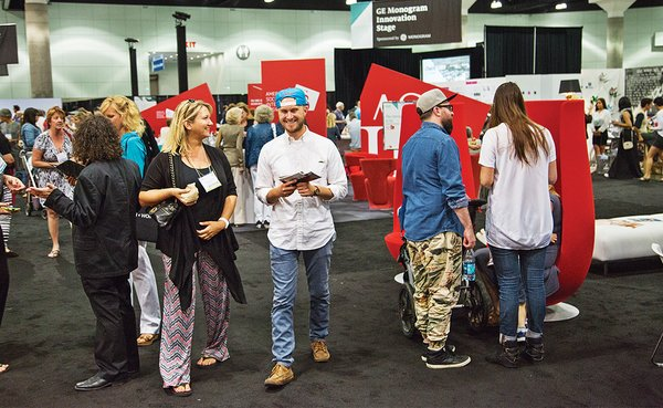The American Society of Interior Designers (ASID) set up a lounge with its signature red hue electrifying the show floor.