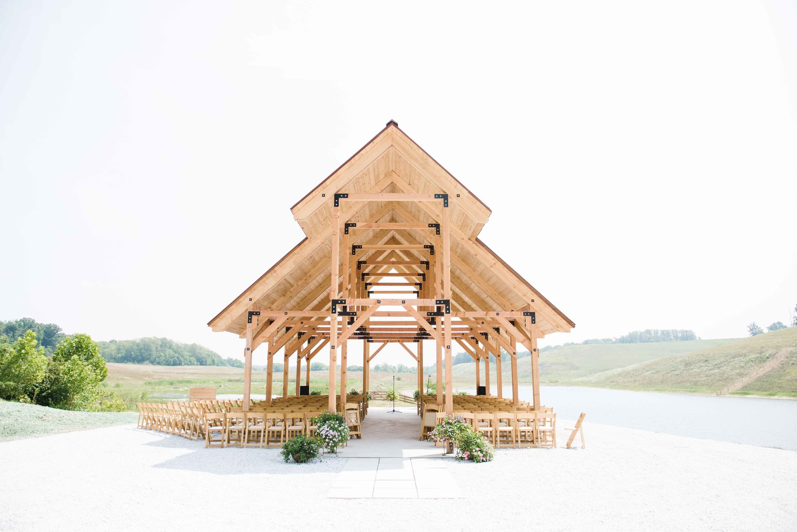 The large open-air pavilion, also overlooking the lake, echoes the retreat's timber construction and natural hues. It hosted the architect's wedding ceremony in the year of its completion, 2014.  Off-Grid Retreat by Zachary Edelson